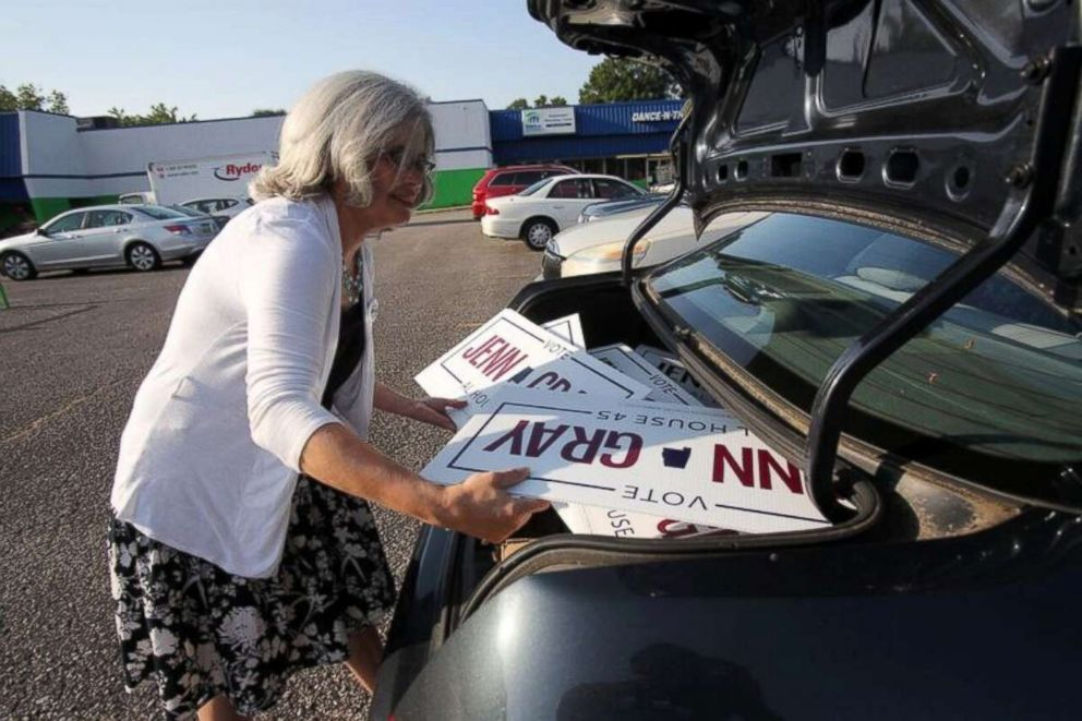 PHOTO: Jenn Gray loads campaign signs for her candidacy for the Alabama state legislature.