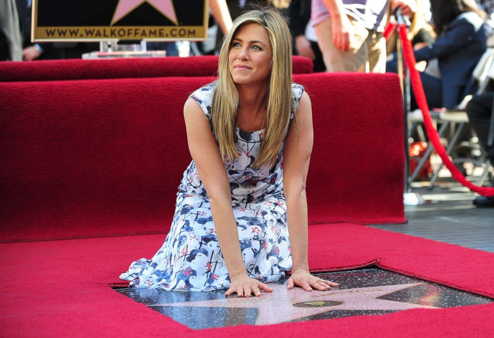 PHOTO: Actress Jennifer Aniston touches her just unveiled Star on Hollywoods Walk of Fame, Feb. 22, 2012, in Hollywood, Calif.
