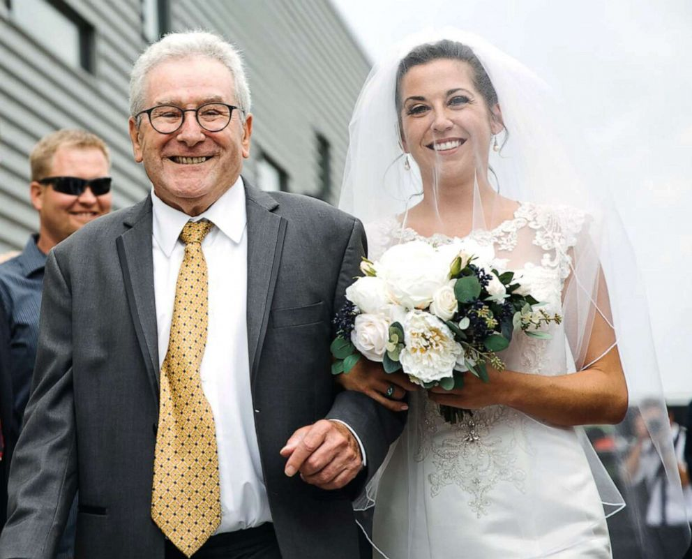 PHOTO: Jim Stamp, 70, accompanied Gina Ross down the aisle using his cane before surprising her by ditching it during their father-daughter dance.