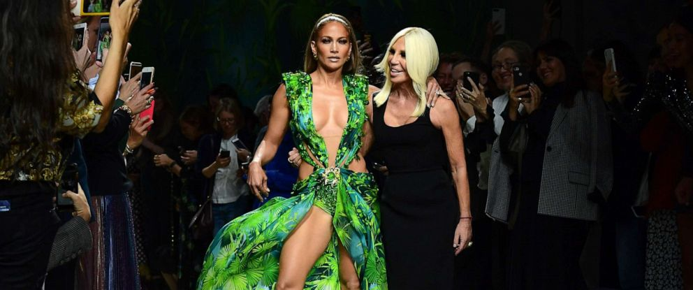 PHOTO: Italian fashion designer Donatella Versace and Jennifer Lopez pose following the presentation of Versaces Womens Spring Summer 2020 collection in Milan, Sept. 20, 2019.
