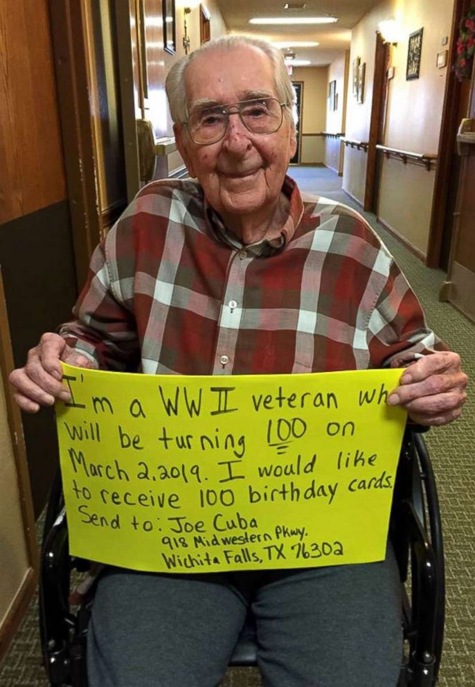 PHOTO: WWII veteran Joe Cuba is photographed here with his sign asking for 100 cards for this 100th birthday.