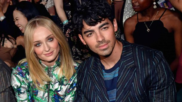 'Game of Thrones' star Sophie Turner says her dad was 'beyond pleased' she married Joe Jonas