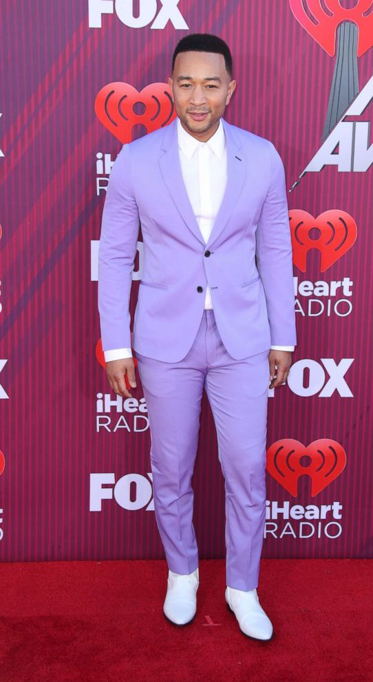 PHOTO: John Legend arrives at the 2019 iHeartRadio Music Awards held at Microsoft Theater at L.A. Live, March 14, 2019, in Los Angeles.