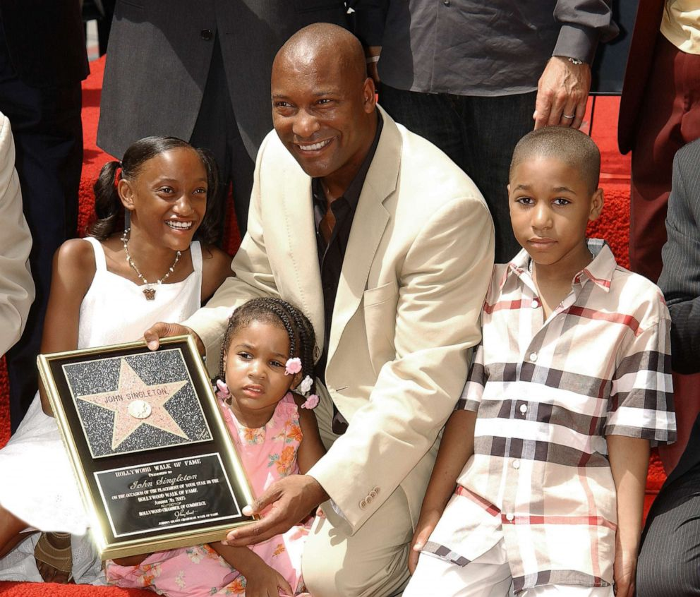 PHOTO: John Singleton with his children, Justice, Cleo and Massai during the ceremony honoring with a star on the Hollywood Walk of Fame, in Hollywood, Calif, Aug. 26, 2003.