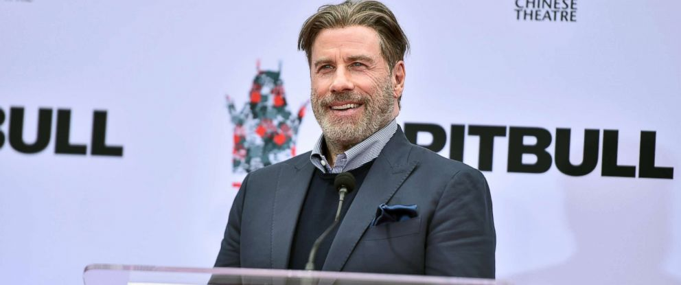 PHOTO: John Travolta attends the Hand And Footprint Ceremony Honoring Pitbull at TCL Chinese Theatre, Dec. 14, 2018 in Hollywood, Calif.