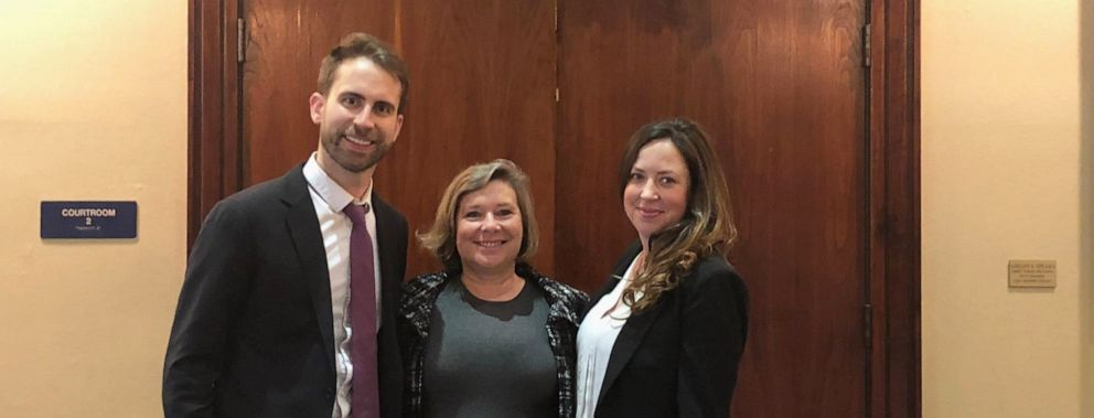 PHOTO: Julie Hilberg, center, stands outside a Texas courtroom with Campaign Legal Center lawyers Mark Gaber, left, and Molly Danahy.