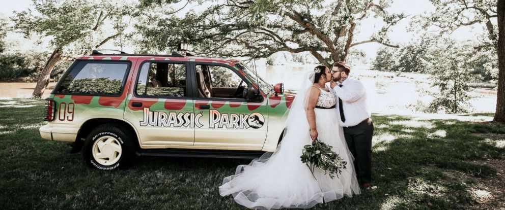 "PHOTO: Courtney and Bill McMillion of Wisconsin hosted an epic soiree on July 7 featuring the popular prehistoric film franchise, ""Jurassic Park."""