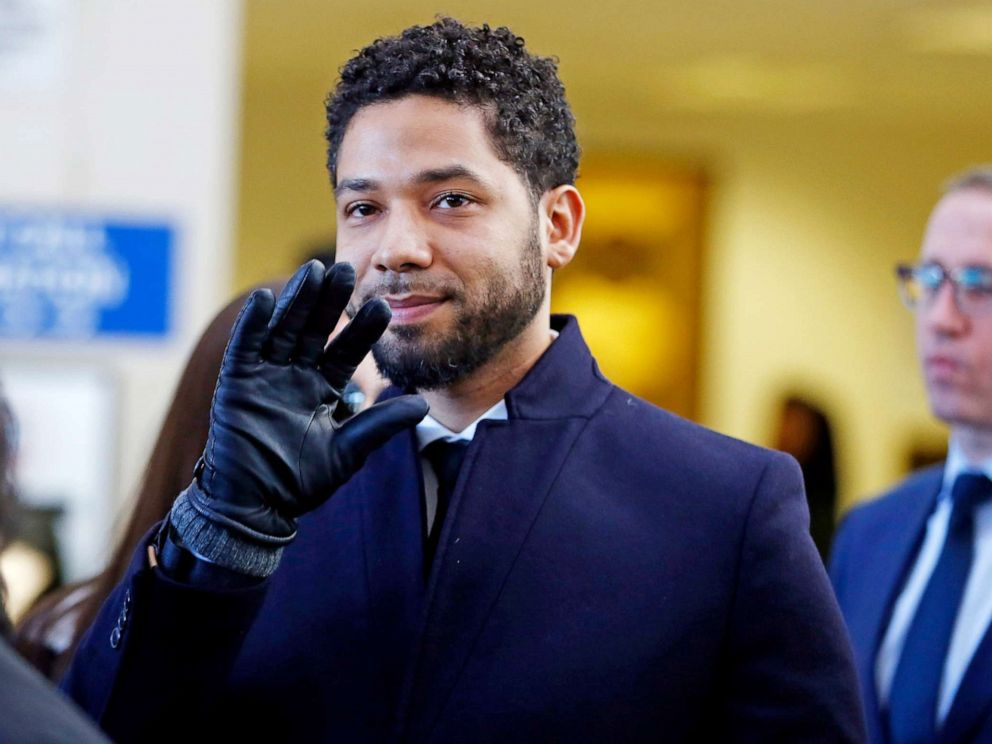 PHOTO: Jussie Smollett waves as he follows his attorney after his court appearance at Leighton Courthouse on March 26, 2019 in Chicago.