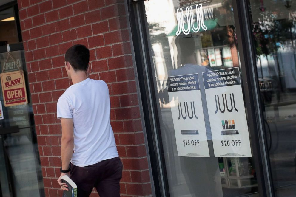 PHOTO: Signs in the window of the Smoke Depot advertise electronic cigarettes and pods by Juul, the nations largest maker of e-cigarette products, on Sept. 13, 2018, in Chicago.