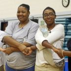 Kamisha Loftin, center, and her daughter D'Amoni Loftin, 12, take part in a Girl Scouts circle at the Maryland Correctional Institution for Women in Jessup, Md., in September 2018.