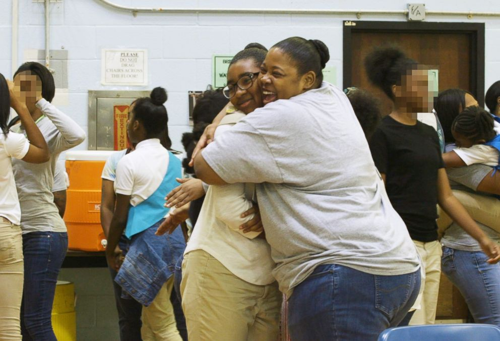 PHOTO: Kamisha Loftin hugs her daughter DAmoni Loftin during a Girl Scouts meeting at the Maryland Correctional Institution for Women in Jessup, Md., in September 2018.