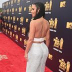 Kim Kardashian attends the 2018 MTV Movie And TV Awards at Barker Hangar, June 16, 2018, in Santa Monica, Calif. | Singer Nicki Minaj is seen at Charles-de-Gaulle airport, April 5, 2018, in Paris.