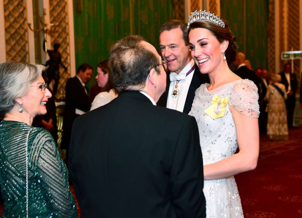 Britain's Catherine, The Duchess of Cambridge, talks to guests at an evening reception for members of the Diplomatic Corps at Buckingham Palace in London, Dec. 4, 2018.