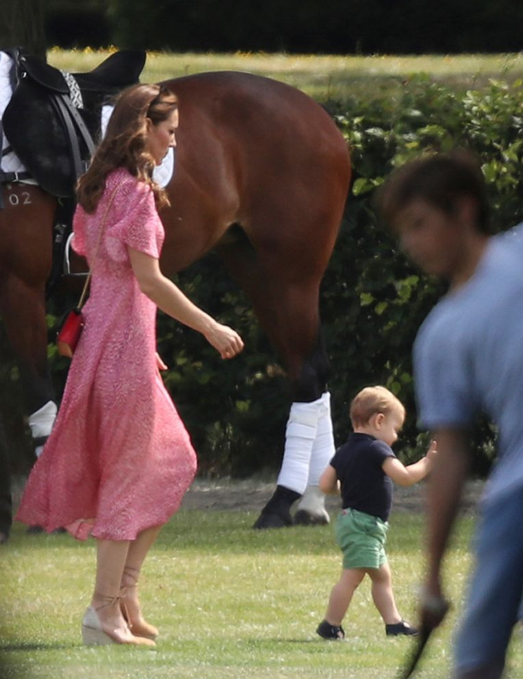 PHOTO: Kate, Duchess of Cambridge runs after her son Prince Louis, at the Royal Charity Polo Day at Billingbear Polo Club, Wokingham, England, on July 10, 2019.