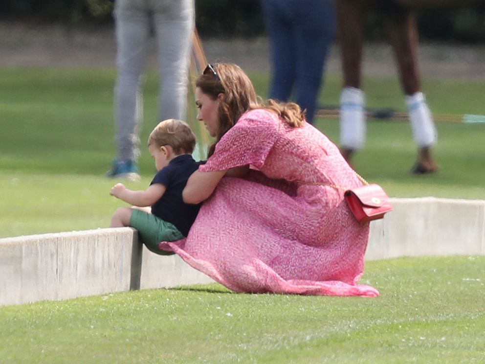 PHOTO: Britains Kate, Duchess of Cambridge and Prince Louis attend the Royal Charity Polo Day at Billingbear Polo Club, Wokingham, England, on July 10, 2019.