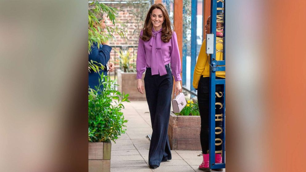 Duchess Kate looks super chic in pants and purple bow blouse