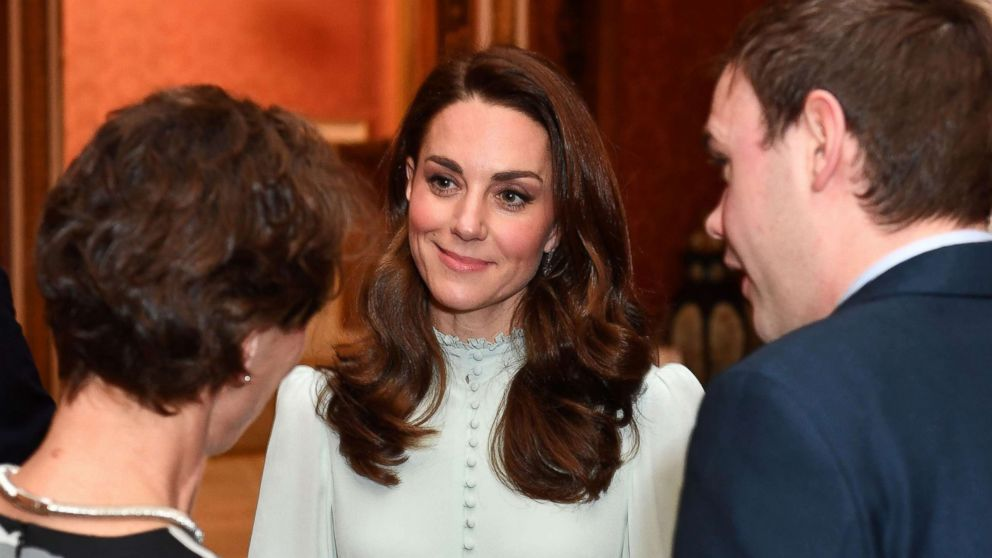 Catherine, Duchess of Cambridge, talks with guests as she attends a reception to mark the 50th Anniversary of the investiture of The Prince of Wales at Buckingham Palace in London, March 5, 2019.