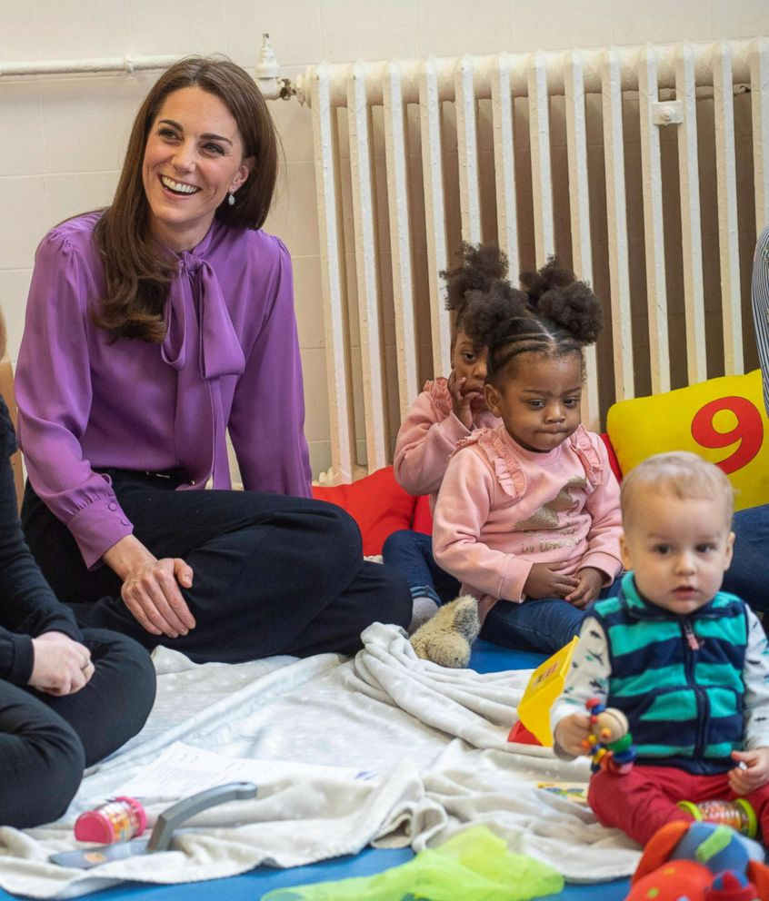 PHOTO: Britains Kate the Duchess of Cambridge sits with children during a visit to the Henry Fawcett Childrens Centre in Kennington, London, March 12, 2019.