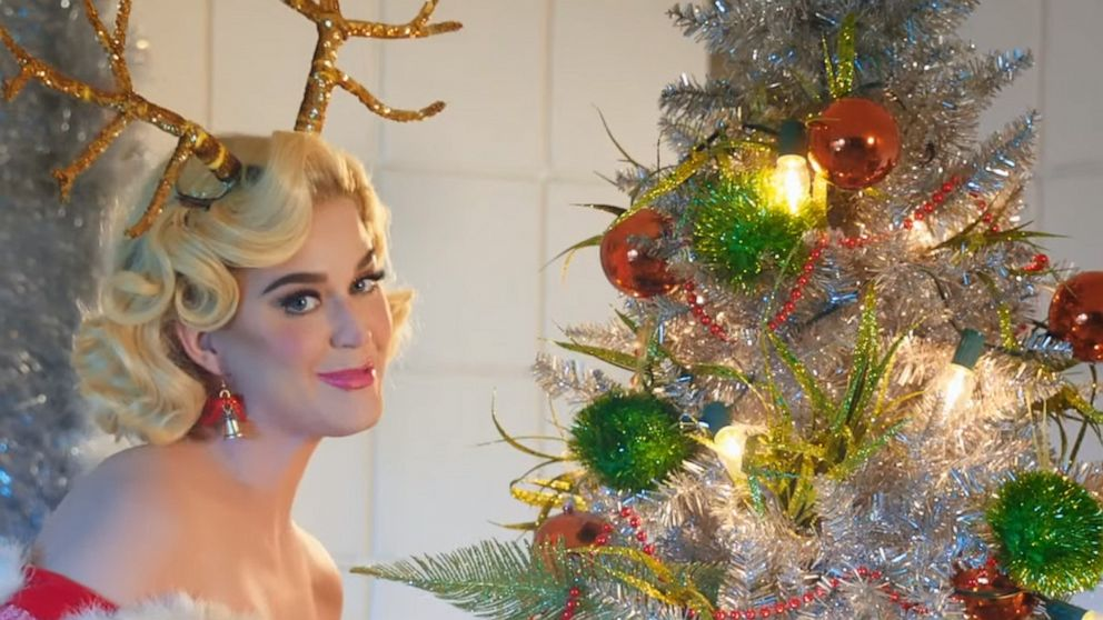 Katy Perry lounges poolside with Santa in new video for ...