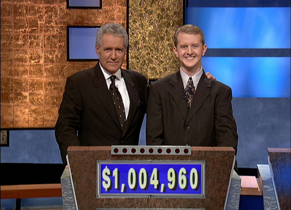 PHOTO: Jeopardy host Alex Trebek poses with contestant Ken Jennings after Jennings record breaking streak on the game show surpassed 1 million dollars, July 14, 2004 in Culver City, Calif.