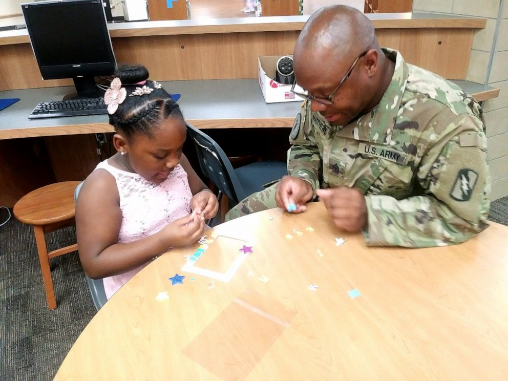 PHOTO: Kevin Matthews, who has been deployed for over a year, surrpised his daughter Kylar Matthews, 7, by attending the daddy-daughter dance at her school in Texas, March 29, 2019.