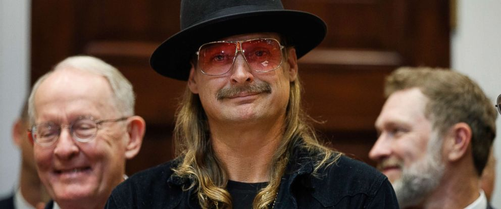 "PHOTO: Musician Kid Rock listens as President Donald Trump speaks during a signing ceremony for the ""Orrin G. Hatch-Bob Goodlatte Music Modernization Act,"" in the Roosevelt Room of the White House, Oct. 11, 2018."