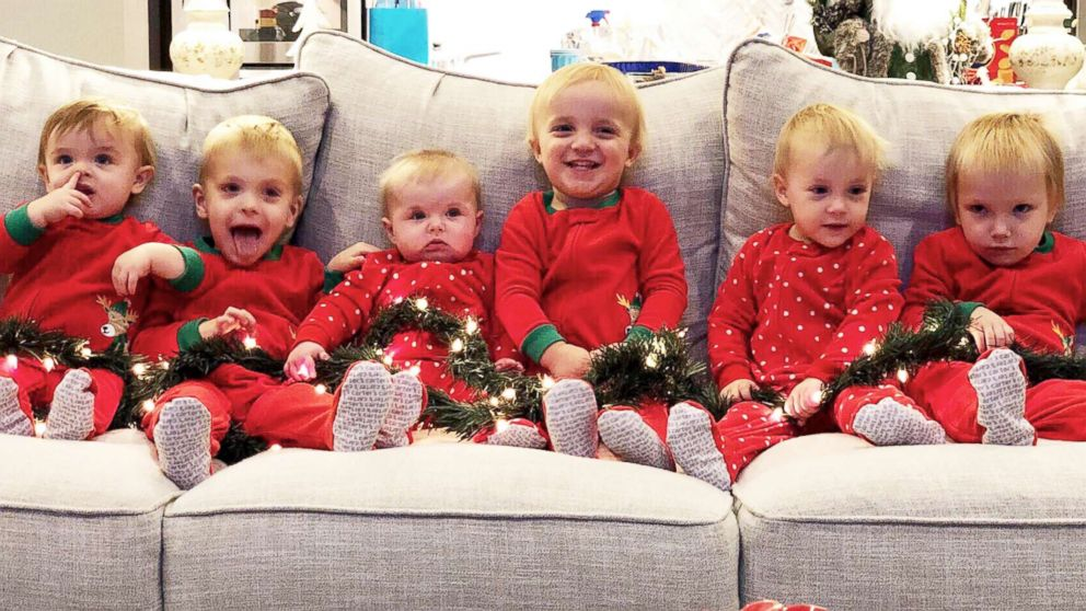 Kids pose for a Christmas photo. From left Hudson Daum (age 1), Carter Daum (3), Abby Eichner (7 months), twins Ben & Sophie Stockburger (2), and Luke Eichner (2).