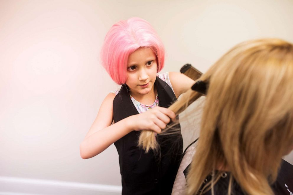 PHOTO: Alivia styled her moms hair during a special photo shoot celebrating her future career aspirations.