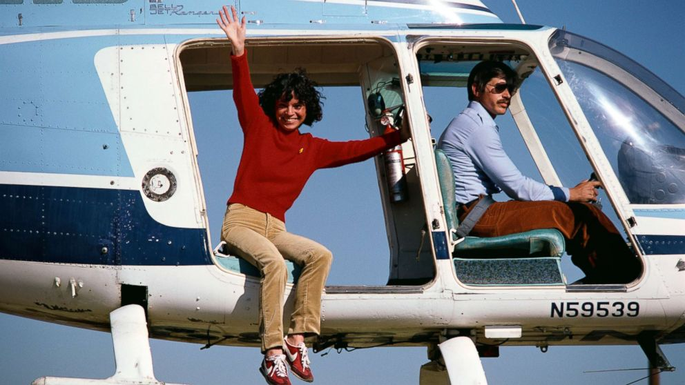 """Stunt performer Kitty O'Neil waves from a helicopter before jumping while doubling for Lynda Carter in the show """"Wonder Woman"""", circa 1979."""