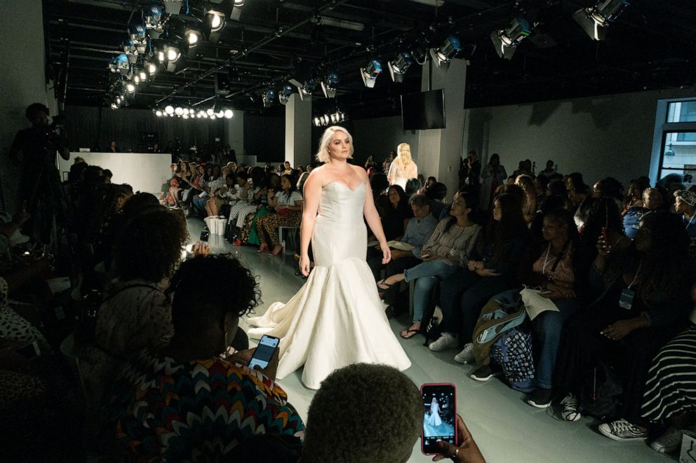 PHOTO: A model walks down the runway at The Knot x Kleinfeld Fashion Show.