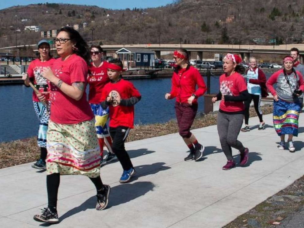 PHOTO: Female runners in KwePack run in Duluth, Minn., on May 5 2019, for the National Day of Awareness for Missing and Murdered Indigenous Women.