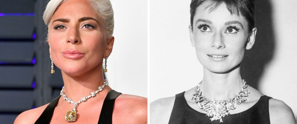 """PHOTO: Lada Gaga wears a yellow diamond to the 2019 Vanity Fair Oscar Party that Audrey Hepburn, right, wore in an image from the filming of the 1961 film, """"Breakfast at Tiffanys."""""""