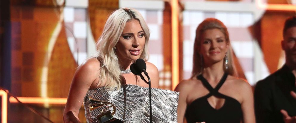 "PHOTO: Lady Gaga accept the award for best pop duo or group performance for ""Shallow"" at the 61st annual Grammy Awards, Feb. 10, 2019, in Los Angeles."