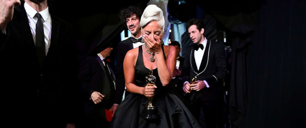 """PHOTO: Lady Gaga reacts holding her award for Best Original Song """"Shallow,"""" backstage at the 91st Academy Awards in Los Angeles, Feb, 24, 2019."""