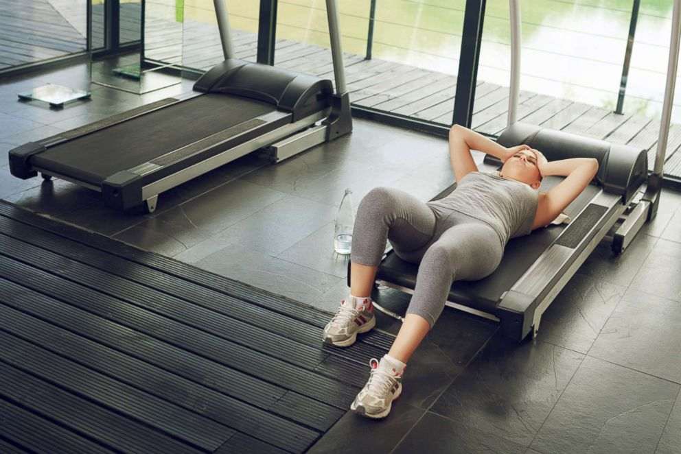 PHOTO: A woman lies down on a treadmill in an undated stock photo.