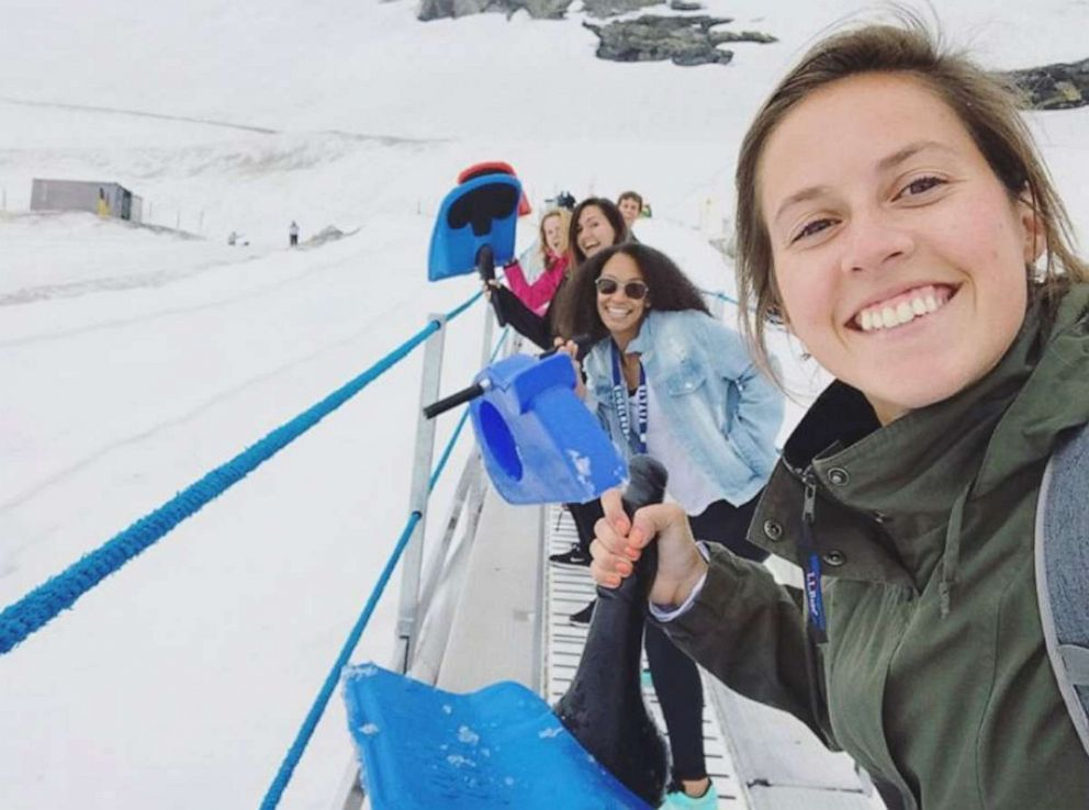 PHOTO: Taking the little electric carpet up to sled down Mt. Titlis with coworkers.