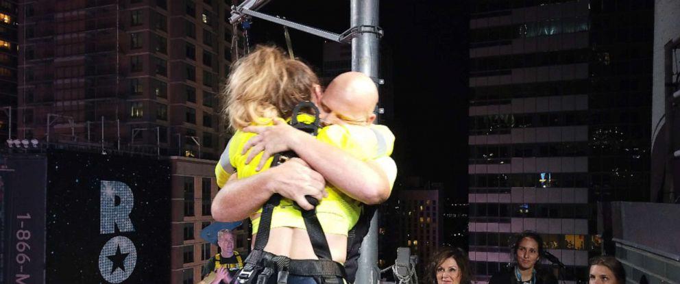 PHOTO: Lijana Wallenda and Nik Wallenda hug on the Highwire Live in Times Square in N.Y., June 23, 2019.