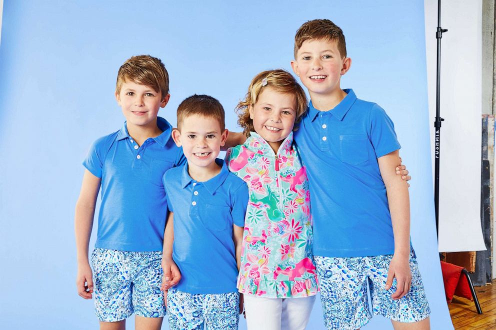 PHOTO: Mary poses with her three brothers in her Magical Mary print.