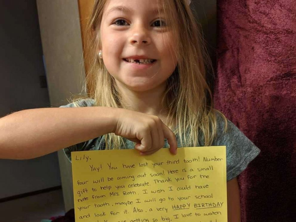 PHOTO: Lily Sciulli, 7, a first grade student at Burchfield Elementary School in Shaler Township, Pa., is shown in this undated photo holding a reply note signed by the tooth fairy.
