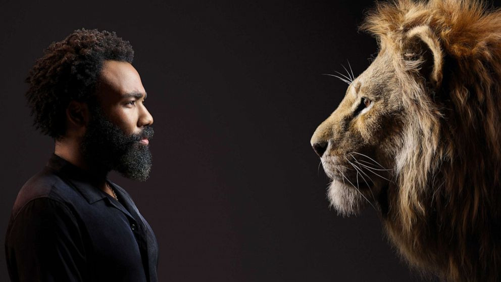 PHOTO: Donald Glover appear beside his Lion King character, Simba.