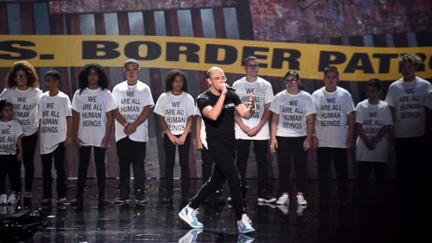 Logic puts hundreds of immigrant children on stage during MTV VMAs performance