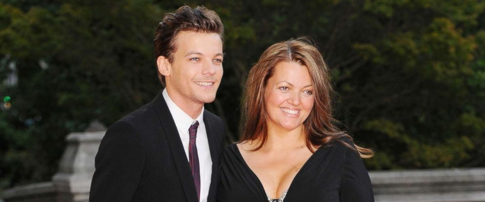 PHOTO: Louis Tomlinson and Johannah Deakin attend the Believe in Magic Cinderella Ball at Natural History Museum, Aug. 10, 2015, in London.