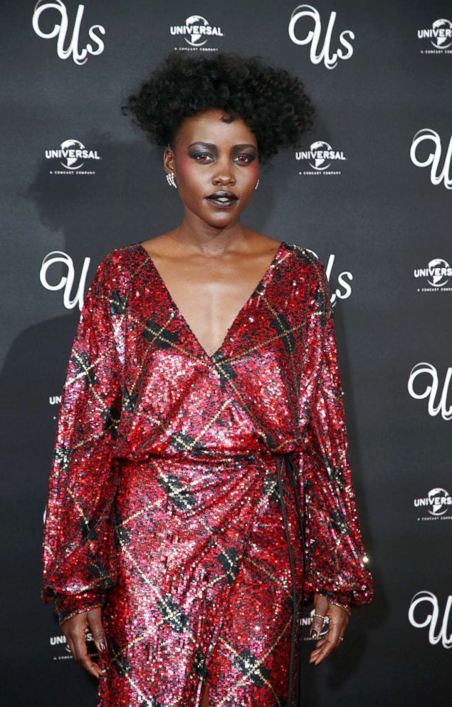 PHOTO: Lupita Nyongo attends the screening of Us at Picturehouse Central, March 14, 2019, in London.