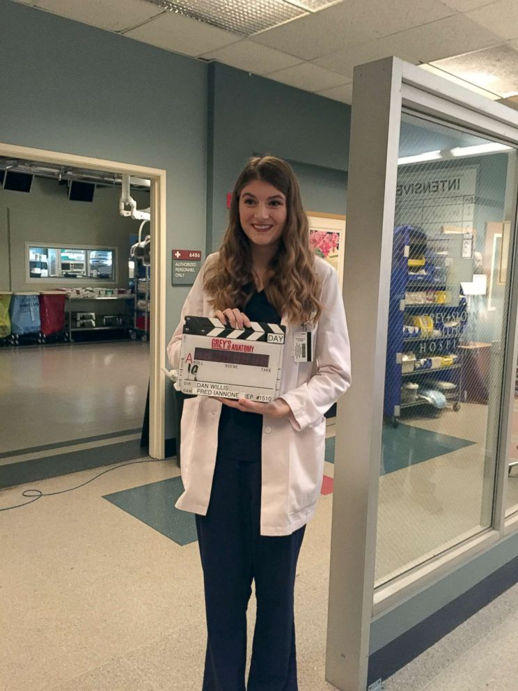 "Izzy directs a scene from ""Grey's Anatomy"" during a set visit thanks to Disney and the Make-a-Wish Foundation"