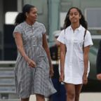 President Barack Obama with first lady Michelle Obama and their daughters Malia, right, and Sasha, left, walk on the tarmac to board Air Force One at Air Station Cape Cod in Mass., Sunday, Aug. 21, 2016.