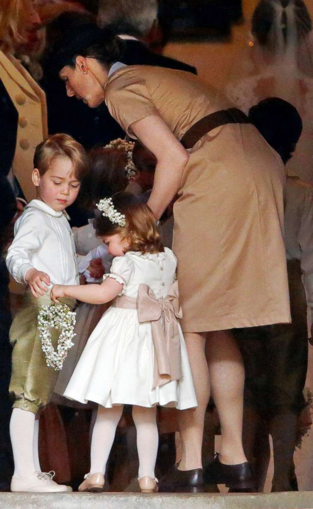 PHOTO:Prince George of Cambridge and Princess Charlotte of Cambridge accompanied by their nanny Maria Teresa Borrallo attend the wedding of Pippa Middleton and James Matthews at St Marks Church, May 20, 2017, in Englefield Green, England.