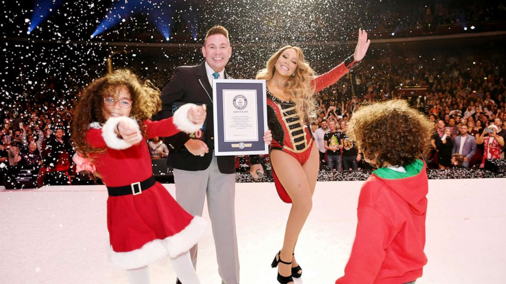 Image result for images of Mariah Carey breaks three Guinness World Records with her Christmas classic song