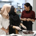 Meghan Markle, Duchess of Sussex visits the Hubb Community Kitchen to see how funds raised by the 'Together: Our Community' Cookbook are making a difference at Al Manaar, North Kensington, Nov. 21, 2018 in London.