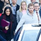 Meghan Markle and Prince Harry arrive at Sydney international airport ahead of the Invictus Games, Oct. 15, 2018.