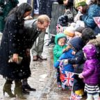 Meghan, Duchess of Sussex and Prince Harry, Duke of Sussex meet children in the crowd as they arrive at the Bristol Old Vic, Feb. 1, 2019, in Bristol, England.